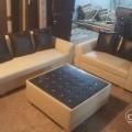 Sofa set with center table near Rander
