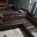 Corner sofa with mechanism handle and headrest