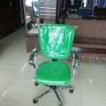 Green revolving office chair